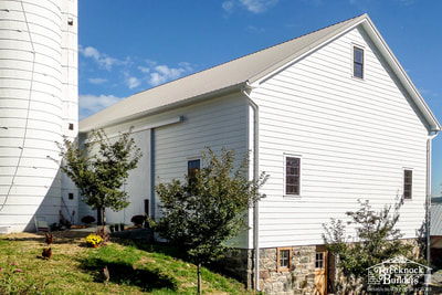 Back of bank barn remodeled by Brecknock Builders