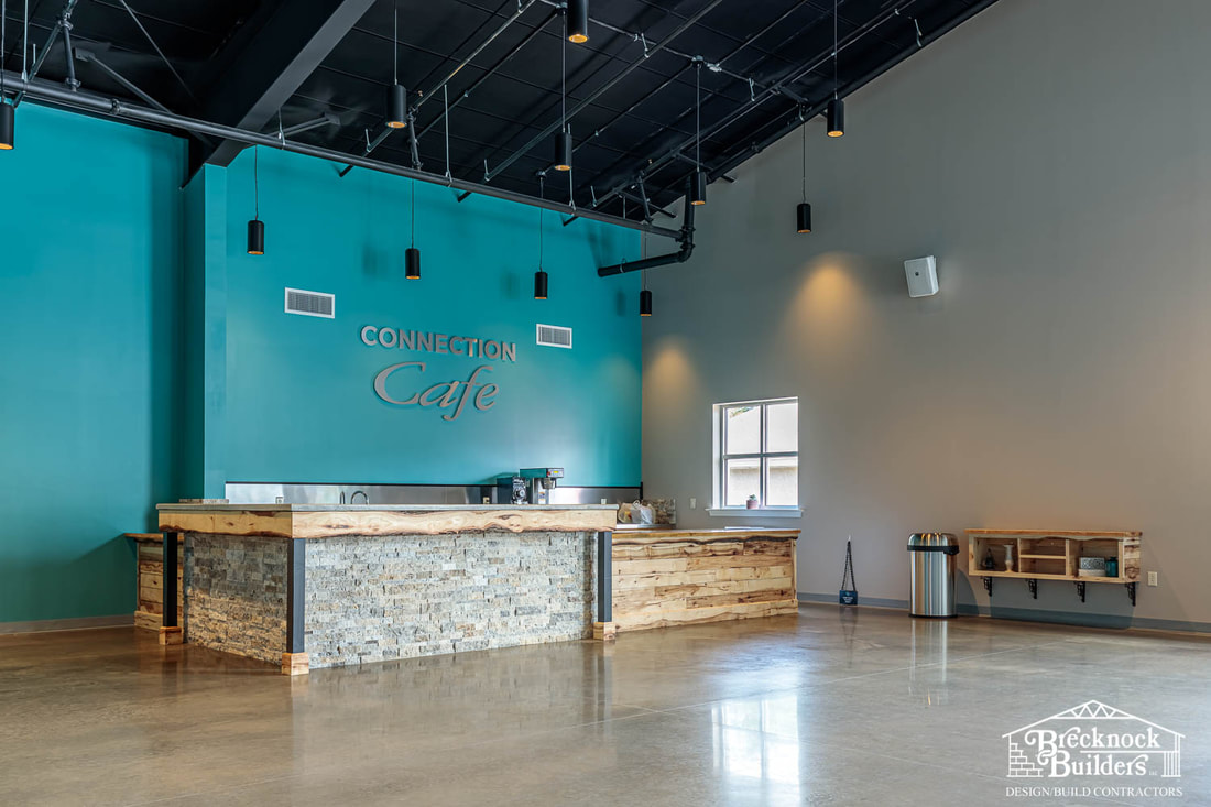 Cafe inside of the pre-engineered steel church building built by Brecknock Builders