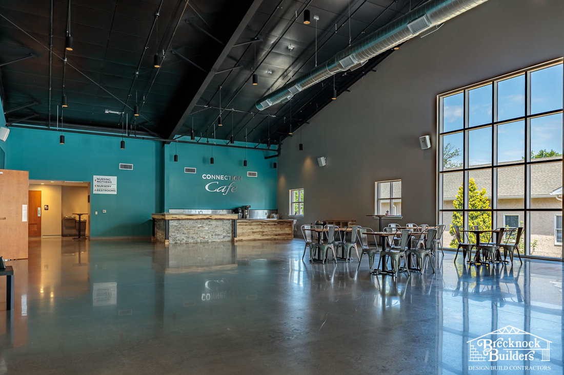 Cafe inside of pre-engineered steel church building built by Brecknock Builders