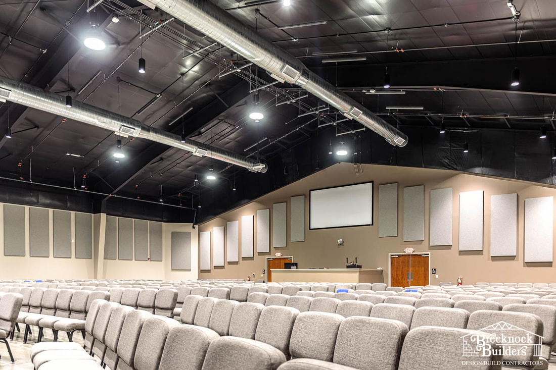 Inside sanctuary of pre-engineered steel church building built by Brecknock Builders