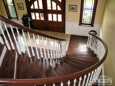 Grand staircase inside custom built home by Brecknock Builders