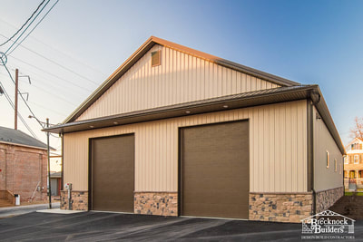 Wood-framed equipment storage and service bays built by Brecknock Builders
